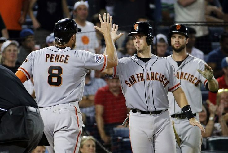 San Francisco Giants' Hunter Pence, left, is high-fived by Buster Posey after Pence hit a three-run home run to score Posey and Matt Duffy during the eighth inning of a baseball game against the Atlanta Braves on Tuesday, Aug. 4, 2015, in Atlanta. (AP Photo/David Goldman) Photo: David Goldman, Associated Press