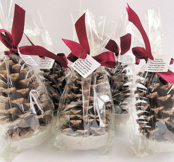 Pinecone Fire Starters: Who needs a fireplace when you can give your guests a pine cone candle to take home? The sweet smell of festive wintery-ness will follow them way past your wedding night.  10 Festive Holiday Wedding Favors You Can DIY or Buy