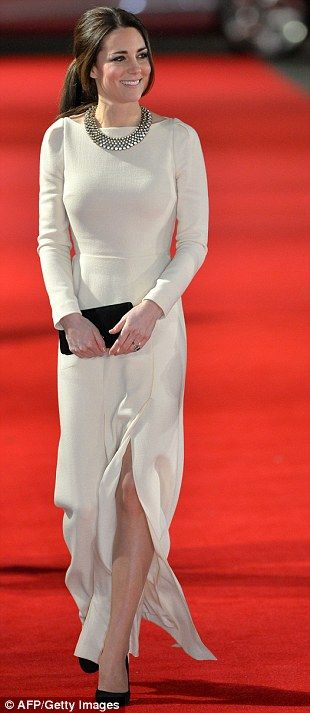 Bargain accessory: The Duchess wore a bespoke ivory Roland Mouret gown to a recent film screening but added a High Street touch with a £19.9...