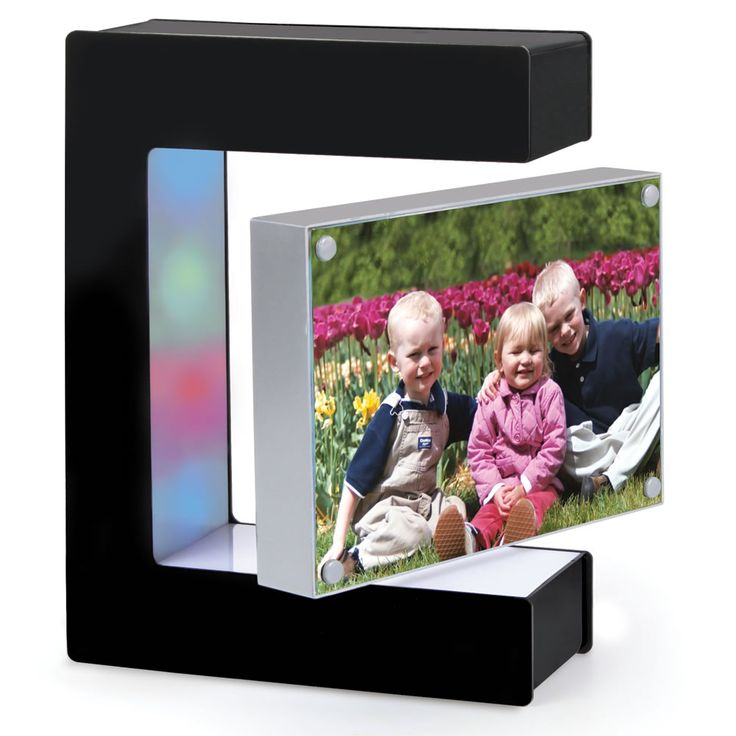 The Hovering Picture Frame - Hammacher Schlemmer - Magnets inside the acrylic photograph case and the three-sided frame create a magnetic field that suspends the photographs in midair.