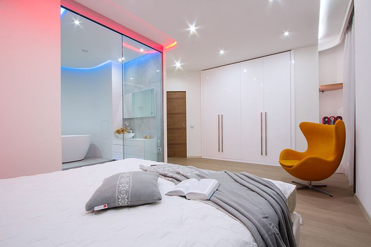 Interesting Pinkish Lighting Combined Among Blue Lighting From Bath Displayed To Beautify Modern Studio Apartment Bedroom