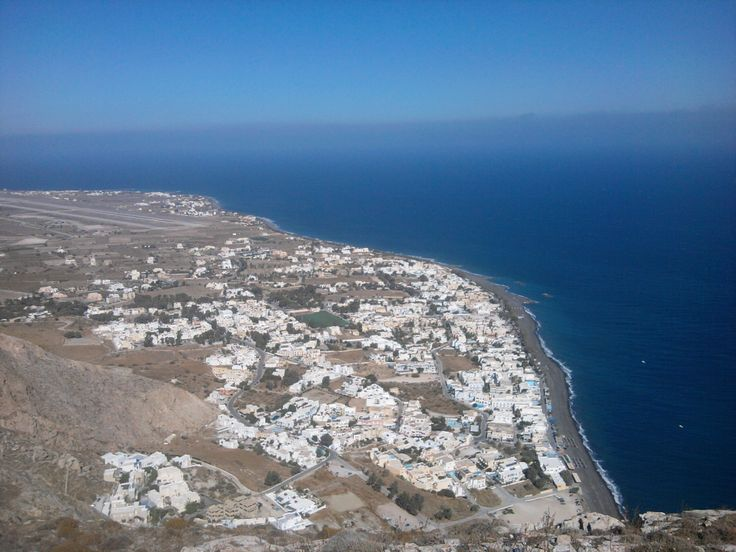 Kamari village & beach (panaromic view- from Ancient Thira)  Monolithos & Santorini airport at the left back of the picture.