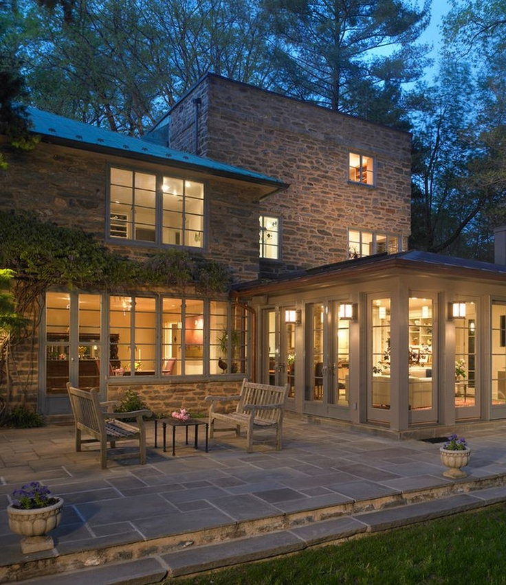 Sunroom addition on 1930's modern stone cottage - love an all stone exterior with modern touches!