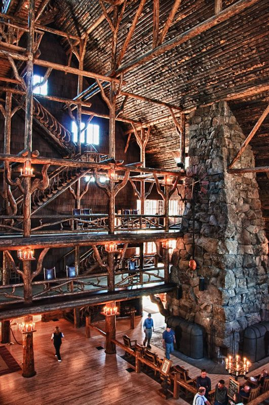 Old Faithful Inn in Yellowstone National Park, Wyoming. They don't use the fireplace anymore. You can't go to the top floor either, but gorgeous treehouse feel.