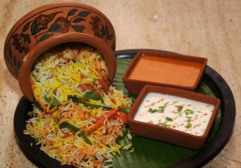 Handi dum biryani - a speciality from Hyderabad, India. Layers of rice and succulently cooked vegetables and/or meat. Served with curd and chutney