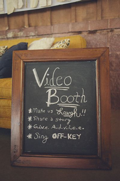 A wedding video booth is where guests go to record a short video with words of wisdom, memories, a message about how fun the wedding was, or well wishes for the couple's future. The result is a fun, interactive video you get to listen to and watch after the honeymoon (and anytime you want)!