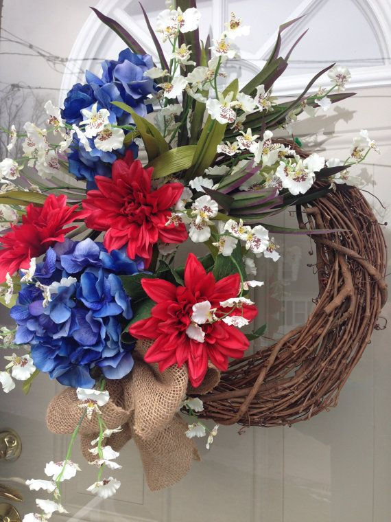 Summer Wreath, Fourth of July Decorations, Red White and Blue, Patriotic Grapevine Decor, Memorial Day Floral, Cape Cod Style Door Hanger  Patriotic and Elegant!! Blue Hydrangea, Red Dahlia and White orchids are artistically designed on a grapevine wreath. Finished with a hand tied burlap bow. Display this wreath all summer on your front door. Perfect decor for a beach style home. Ready to Ship!  Made and Ships from a Pet Free and Smoke Free home. Suitable for indoor/outdoor use. See my ...