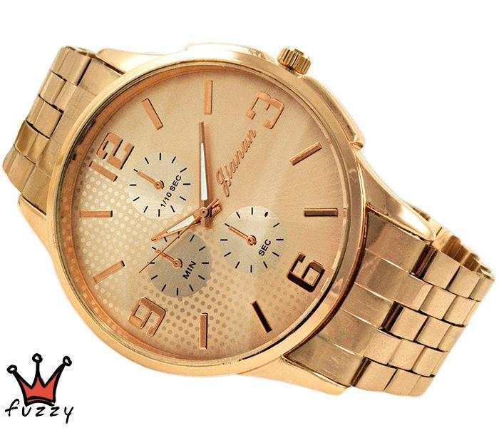 Γυναικείο ρολόι, σε ροζ χρυσό χρώμα και ροζ στο εσωτερικό μεγάλου μεγέθους καντράν του.  Ανοξείδωτο ατσάλινο μπρασελέ.  Διάμετρος καντράν 50 mm