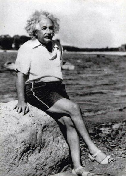 Albert Einstein crosses his legs when he sits and wears feminine shoes. That's priceless!