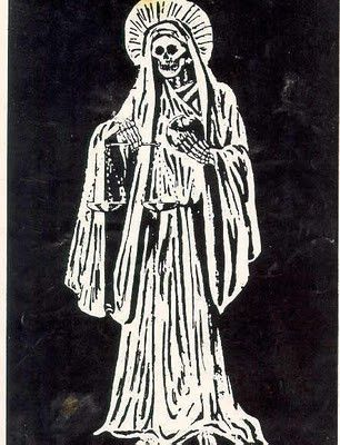 """La Santisima Muerte is a """"banned saint,"""" the Roman Catholic """"cover"""" for an ancient Aztec goddess named Mictecacihuatl, a death goddess and co-ruler, with her husband of the underworld. She is said to be a protectress, of just judgement & karma, and is said to keep husbands faithful. Her crystal ball represents her reach into the world of the living."""