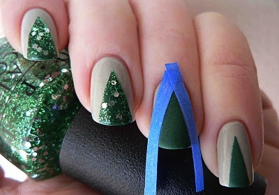 Christmas tree nails. PAINT TAPE! That's brilliant. Last time I used regular tape it peeled off my polish. :P You could use this for any nail design!!!