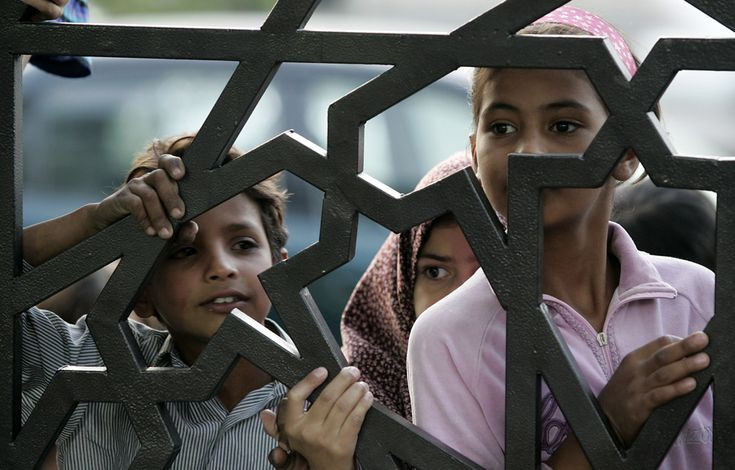 3. Jordanian Muslim girls queue in line outside a humanitarian center for waiting for meals to be donated at the time for the breaking of their fast, or Iftar, on the 13th day of the Muslim holy fasting month of Ramadan in Amman, Jordan, Saturday, Sept. 13, 2008. (AP Photo/Nader Daoud)
