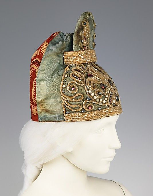 This headdress, from Tver is heavily adorned with mother-of-pearl beads.
