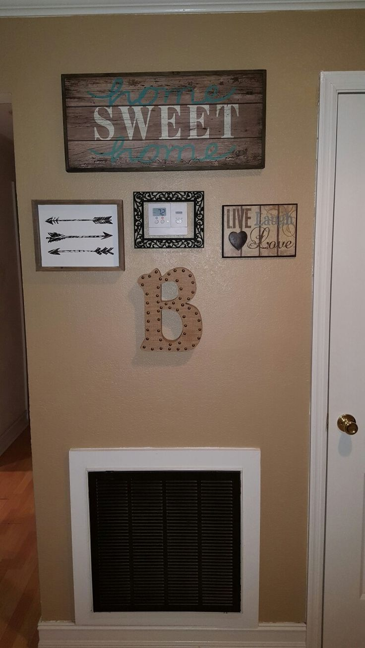 Hiding ac thermostat with picture frame.