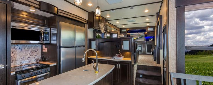 The Momentum Fifth Wheel Toy Hauler is the point where absolute luxury meets mobile garage! We have completely raised the Toy Hauler bar by incorporating an elegant Master Bath and Master Suite (with full walk-in closet) into this unit! But trust us, we didn't ignore the Living and Garage areas.