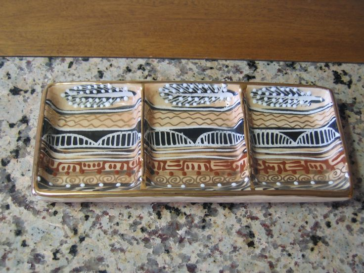 Sectioned, hand-painted ceramic tray from Johannesburg, South Africa.  Great for spare change, keys, hair ornaments or...?
