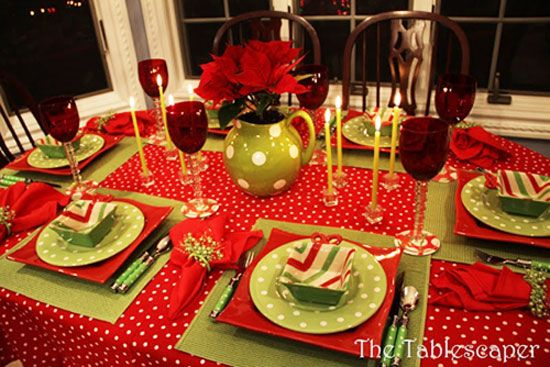 Christmas Table Ideas: Decorating with Red and Green - I love polka dots and they look fabulous on this table. The elegant glassware and ultra-slender tapers bring an elegant touch to this merry setting.