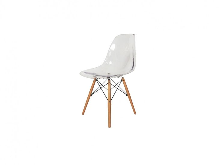 Designed by Charles and Ray Eames in 1950. The shell of this side chair is crafted in one mould from clear polycarbonate that makes this chair ultra-modern and almost transparent in certain light.
