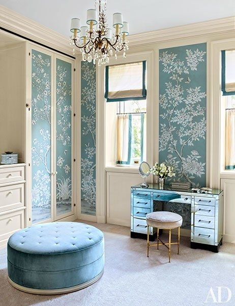 A dressing room, lined in a hand-painted Gracie wallpaper, is furnished with an American mirrored desk and an Italian brass stool | archdigest.com
