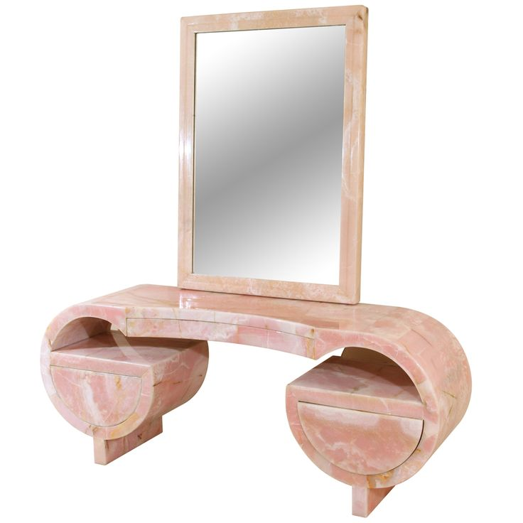 Stunning and highly unique art deco Pink Marble and Lucite Vanity and Mirror. Circa 1930s US. Quintessential Hollywood glamour. From 1stdibs.