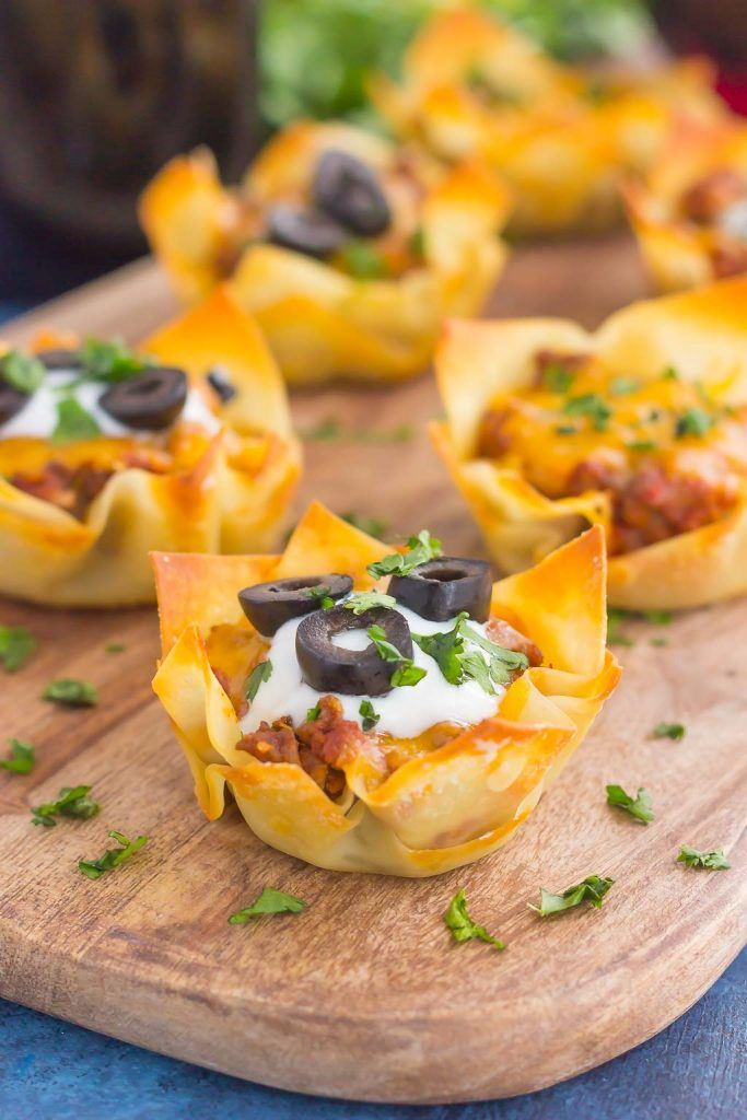 These Cheesy Taco Cups are the perfect game day snack. Your favorite taco ingredients are layered in wonton wrappers and baked in mini form. Easy to make and even better to eat, you'll enjoy these handheld cups that are packed with so much flavor! #FronteraGameDay #ad @fronterawines