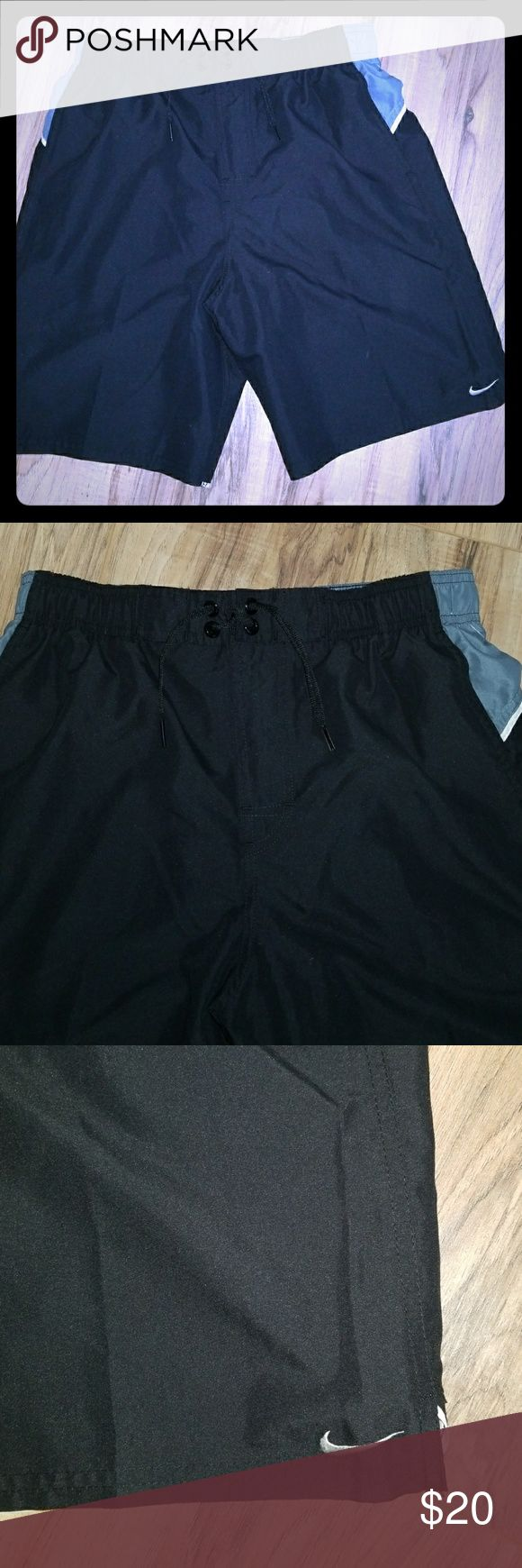 New men's Nike swim shorts black size small Never worn, new black swim shorts by Nike size small.  Has built in liner. Nike logo Nike Swim Swim Trunks