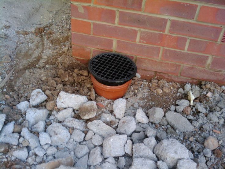 The drain, which includes a removable lid to clean rubbish out. As the garden is on a slight slope the patio will flow toward and along the house - otherwise we would have to have a wall between it and the grass.