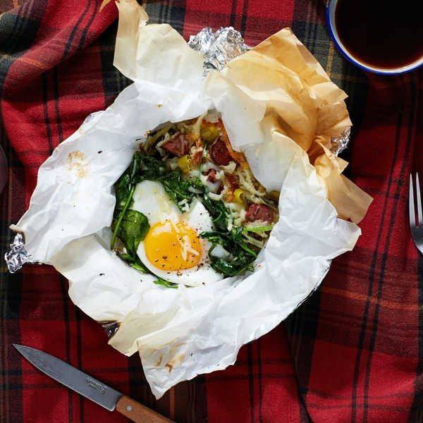 These make-ahead packs are perfect for camping trips as well as quick and easy breakfasts on the go. Shredded potatoes and flavorful sausage are topped with baked eggs and spinach for a hearty morning meal.