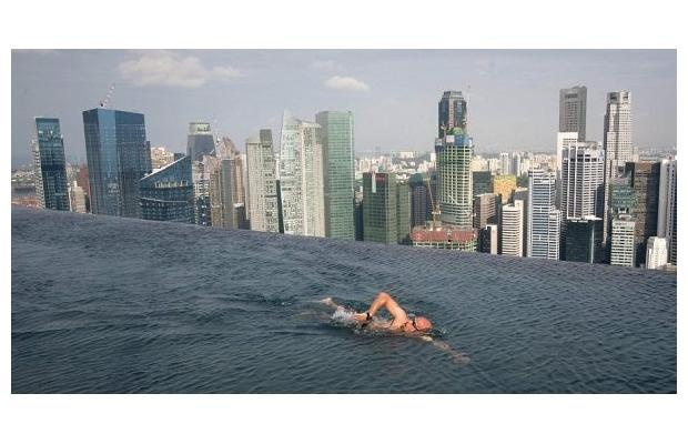 """Marina Bay Sands pool, Singapore For sheer """"wow"""" nothing can beat the infinity pool at the $4-billion Marina Bay Sands resort in Singapore, which opened in 2010. At 55 storeys above ground, the pool stretches 150 metres, three times the length of an Olympic swimming pool. It is the largest outdoor pool in the world at that height."""
