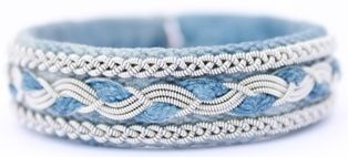 *RIST is a bracelet here shown in blue denim leather with braids in pewter wire, from AC Design Price: 72 €