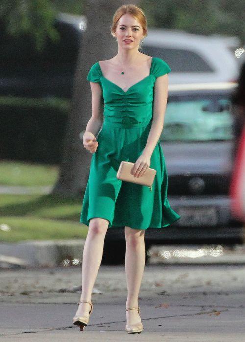Emma stone stuns in a green chiffon dress with golden heels