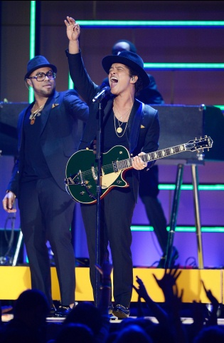 I wish I could go to the Bruno Mars concert all over again!! I miss it! It was the BEST!! His guitar and drum solo's were the best!! He was super funny! I love his personality! Peter Gene Hernandez, is the best!:))