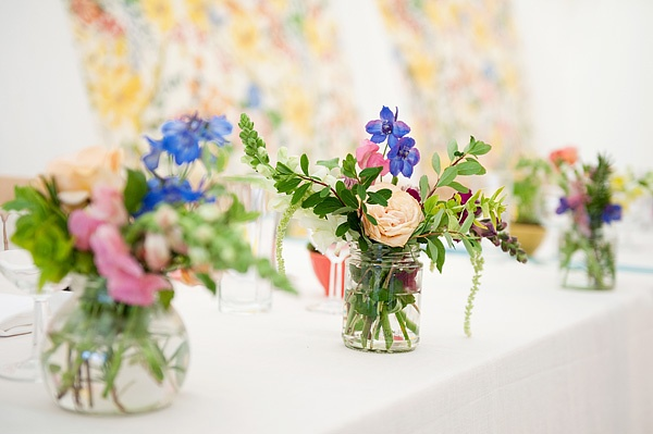 flowers in jam jars... although mine will be more mismatched :)