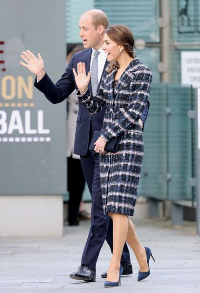 Kate Middleton Photos Photos - Prince William, Duke of Cambridge and Catherine, Duchess of Cambridge wave to wellwishers after touring the National Football Museum during their visit to Manchester on October 14, 2016 in Manchester, England. - The Duke & Duchess Of Cambridge Visit Manchester