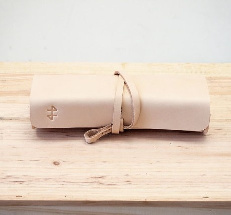 A hand crafted pencil case made of a vegetabel tanned leather finished with wax.