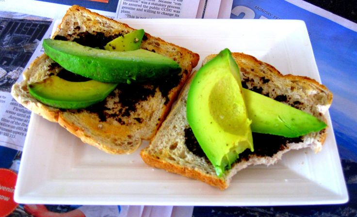 Put a spin on breakfast - avocado and marmite on toast! More recipes and inspiration on www.theglamcurl.com