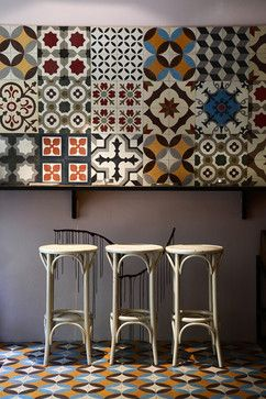 Celebration of encaustic tile-- migration to the wall! Actually these seem to be contemporary encaustic tiles by Karoistanbul and this may be a showroom shot ??