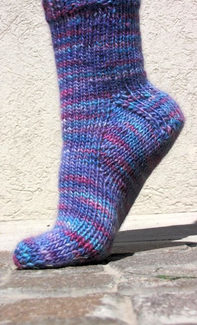 KnitFreedom - Magic Loop Toe up Socks - FREE pattern.  Bonus - learn to knit two socks at a time!  She also has help videos on YouTube. Worsted weight