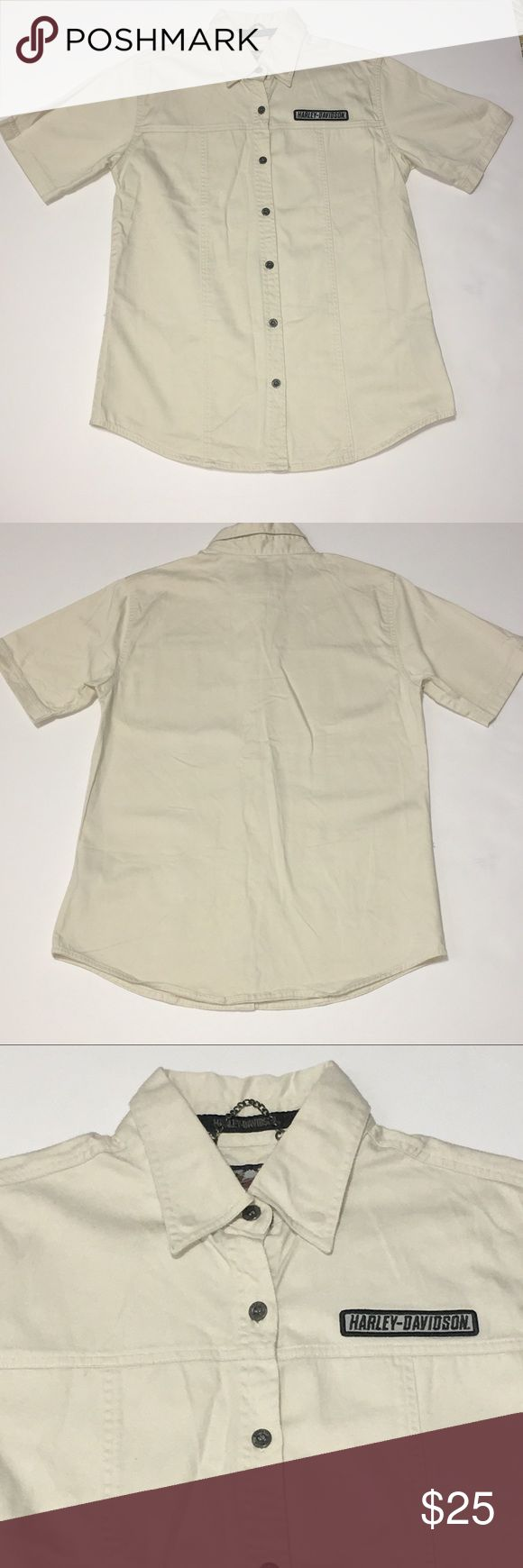 """Harley Davidson Cotton Button Front Camp Shirt SM Women's beige Harley Davidson Camp / Utility shirt.  100% Cotton. Button front. Harley patch on front.  Size small.  Approximate Measurements:  Bust Flat - 19"""", Shoulders Flat - 16"""", Hem Opening Buttoned - 20"""", Overall Length - 27"""". Excellent gently loved condition and from a smoke free home. Harley-Davidson Tops Button Down Shirts"""