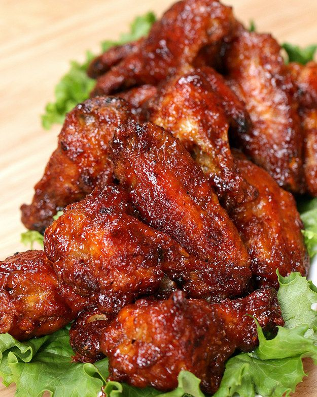 Honey BBQ Chicken Wings | INGREDIENTS 1 cup flour 1 tsp chili powder 1 tsp kosher salt 1 tsp freshly ground black pepper 1 tsp paprika 1 tsp garlic powder 20 chicken wings or drumettes  1 cup BBQ sauce ½ cup honey PREPARATION Preheat oven to 425°F. In a bowl, combine flour, chili powder, salt, pepper, paprika, and garlic powder. Coat the wings in the flour evenly, shaking off any excess. Place the floured wings on a parchment paper–lined baking sheet and spread them out in a single layer…