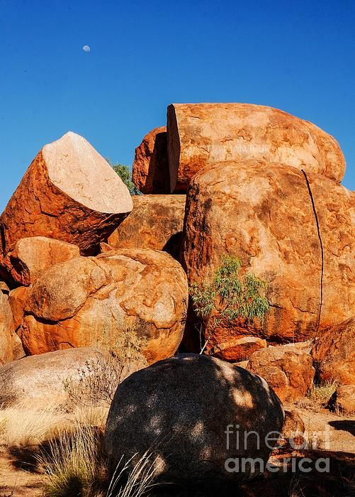 Split Rocks Devils Marbles,Northern Territory. FASCINATING ROCKS. There is a great fascination for rocks. The colours, textures, patterns. How they were formed and re formed. they make you ponder - their history, their story. Visit my photo gallery and get a beautiful Fine Art Print, Canvas Print, Metal or Acrylic Print. OR visit my site to see more rockscapes. 30 days money back guarantee on every purchase so don't hesitate to 'ROCK your home or office!