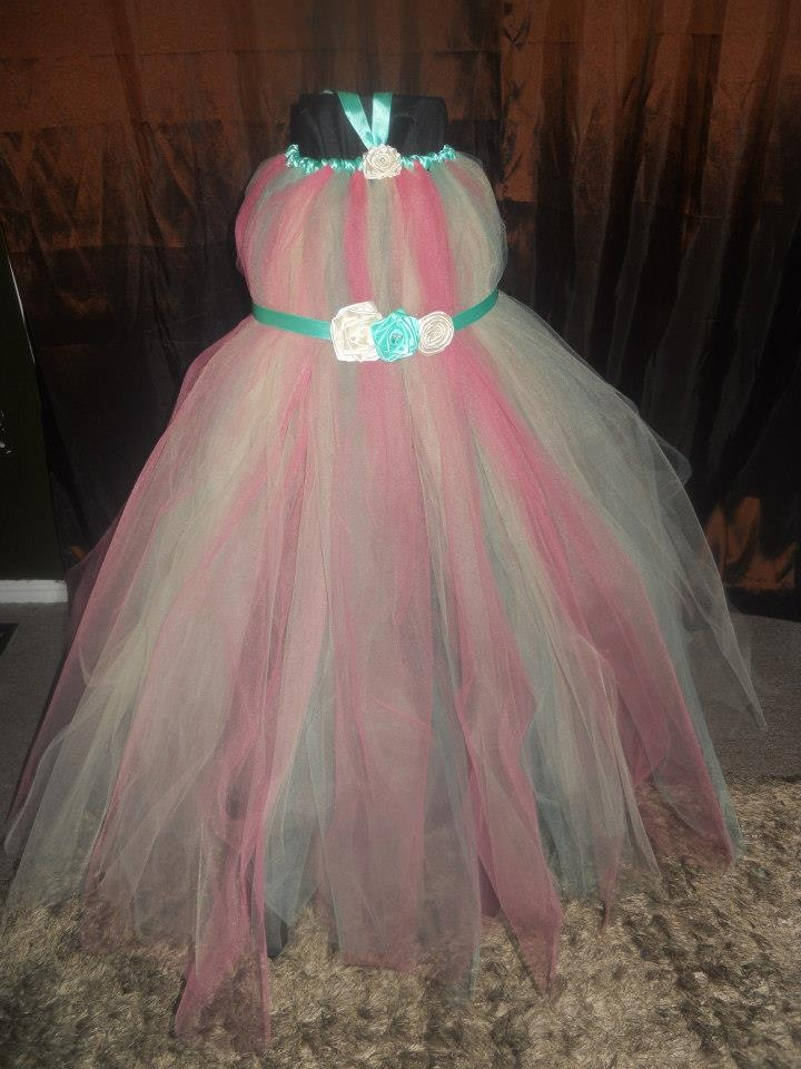 Handmade by Candy's Creations    Little Princess Tutu Gown - Average size 4-5 years.    Beautiful Antique Pink, Dusty Green and Champagne Tutu Gown. Accented with a light Aqua Green Satin Tie Back Sash, Ivory and Aqua Green Satin Handmade Flowers, an Satin Aqua Green Halter Satin Ribbon and Pearls.    Price: $55  Shipping: Send Message  http://www.facebook.com/CandysCoutureCanada