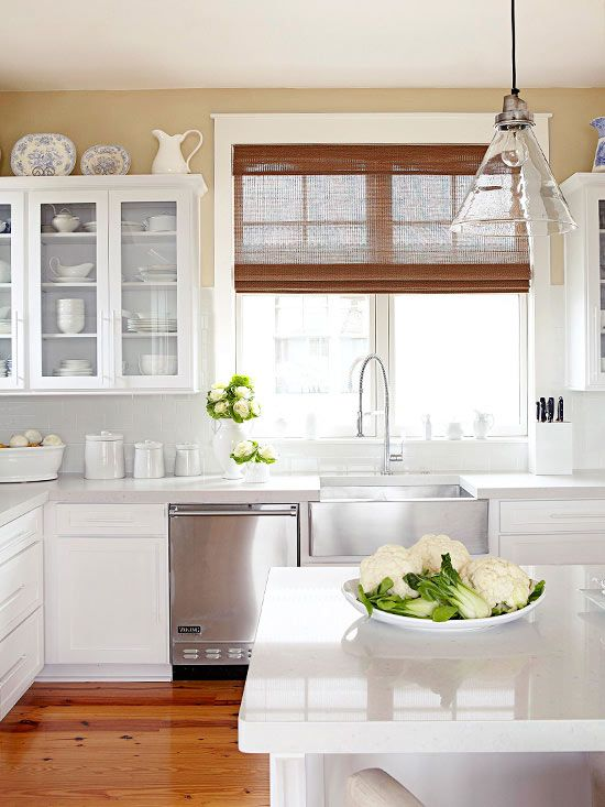 warm up a bright kitchen with wood accents get more kitchen ideas here http www bhg com on e kitchen ideas id=63627