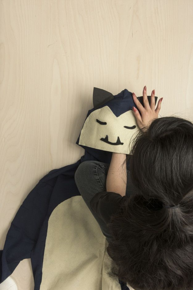 The final step is to glue on the face and then glue on the ears. | Here's An Easy Snorlax Costume Anyone Can Make