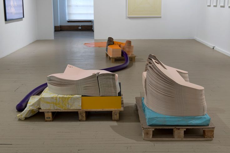 Seripop - Yannick Desranleau and Chloe Lum - Riffed An Utterance 2014 Screenprinted paper, rubber, palettes, MDF, Formica, Tyvek, polyethylene. Variable dimensions 777 x 226 x 81 cm    Installation view of Echo I group show at Galerie Hugues Charbonneau, Montreal, Canada, April 19 - May 24, 2014.  Photo by Éliane Excoffier