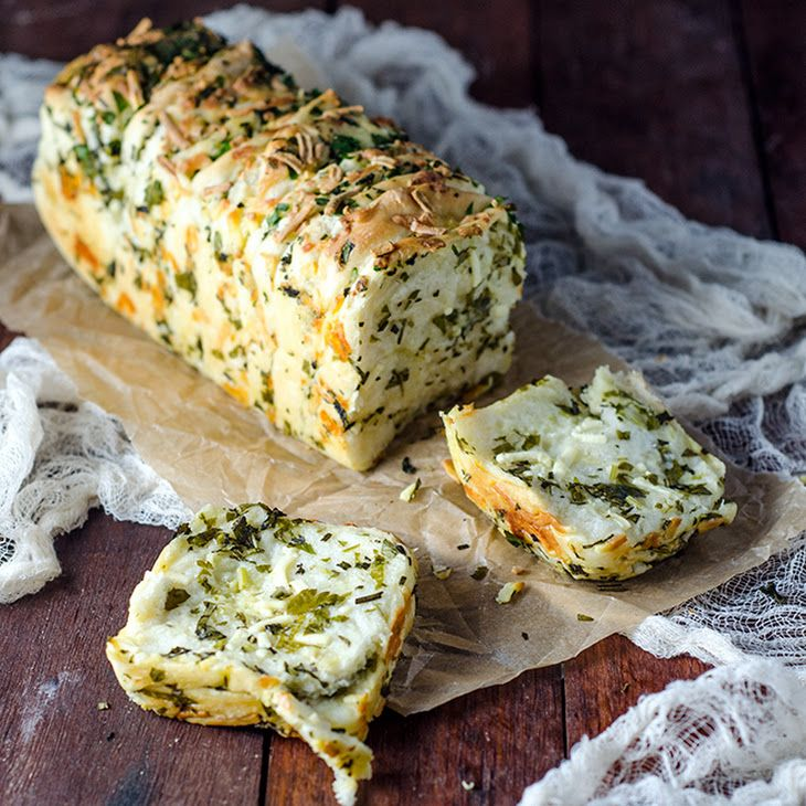 Garlic Herb and Cheese Bread Recipe Breads with plain flour, yeast, salt, sugar, bread improver, water, olive oil, garlic cloves, parsley, basil, rosemary leaves, butter, cheese