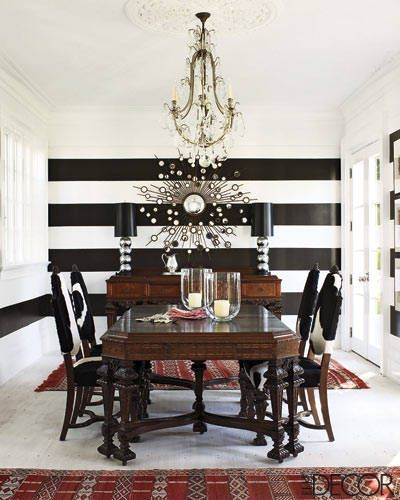 Striped walls, cowhide chairs, and Moroccan rugs.