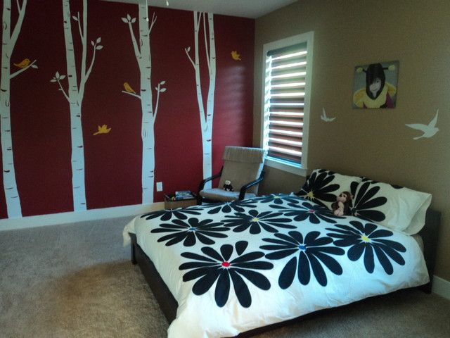 Liking the trees and the color scheme but the bedspread just doesnt seem to belong.