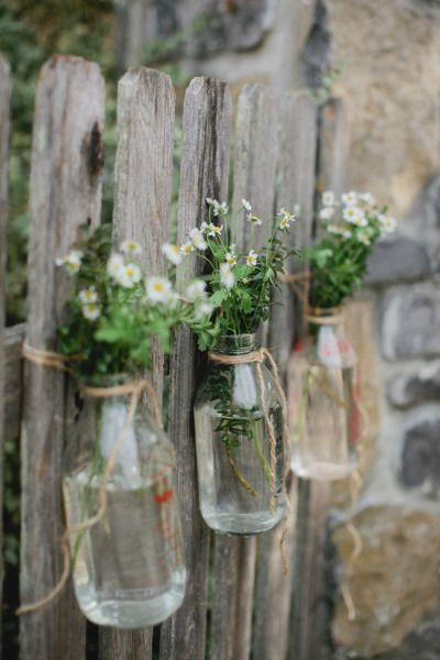 flowers strung in glass jars