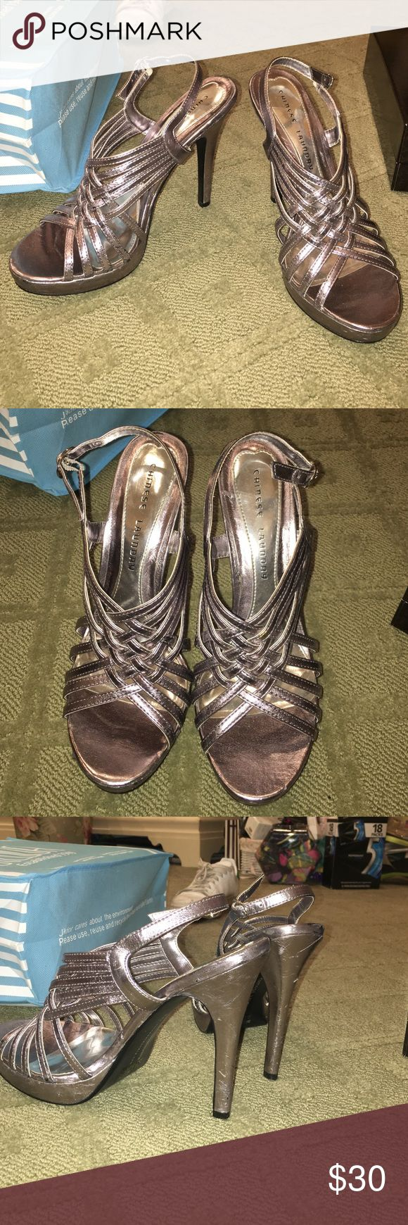 Gun metal strappy pumps Chinese laundry strappy heels with small platform. The color is like a dark silver / gun metal. Super cool color. The back is adjustable. In decent condition, but a little scuffed up. Size 9, but run a little small. Closer to a size 8. Chinese Laundry Shoes Heels